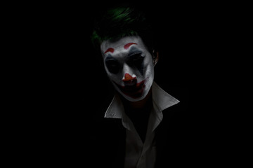 Makeup for Halloween: Image of a man in a joker makeup