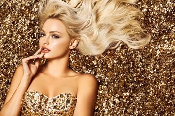 Beautiful blonde woman in golden flowers garden