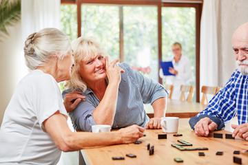 Seniors enjoy the domino game