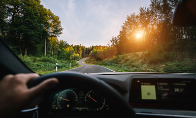 hands of car driver on steering wheel, road trip, driving on highway road