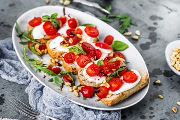 Italian bruschetta with chopped tomatoes, basil and mozzarella on grilled crusty bread