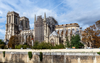 Notre Dame de Paris under reconstruction in October 2019. Wood Shoring now prevent the flying buttresses from collapsing.