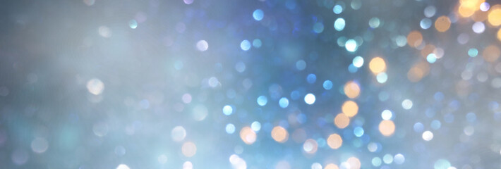 abstract glitter silver, gold , blue lights background. de-focused. banner