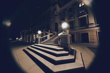 Vienna, Austria - 23 September 2019: The entrance to the Shoenbrunn Palace at night, super-ultra-wide lens view