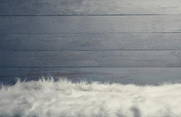 white fur floor wooden wall background