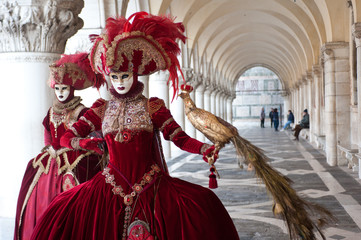 A pair of masks perform for the Venice carnival in Piazza San Marco. Italy.