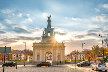 Branicki Palace in Bialystok in Poland at sunlight in autumn scenery. The entrance gate to the palace.