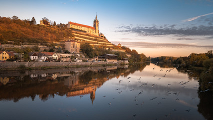 Beautiful Panoramic view of an famous historical city, during a vibrant autumn sunrise. Located in Melnik with historical castle and river Vltava and famous vineyards. Melnik is 30 km north of Prague