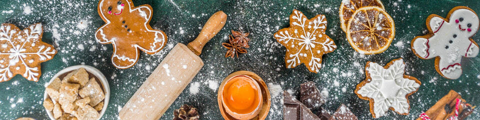 Christmas, New Year cooking background. Baking ingredients and utensils - flour, rolling pin, gingerbread, milk, eggs. Making festive Christmas sweet cookies. Top view copy space
