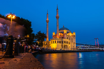 Ortakoy mosque and the bosphorus bridge at night in Istanbul, Turkey.