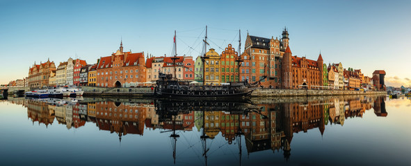 Big panorama of the Gdansk old town and famous crane at sunrise, Poland