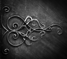 Metal forged gate elements, in dark tones.