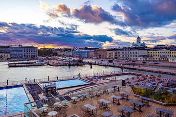 Helsinki. Finland. Panorama of the waterfront of Helsinki. Recreation area in Helsinki harbour.Outdoor swimming pool in Finland.Nicholas cathedral. Water excursions to Helsinki.Finland on a cloudy day