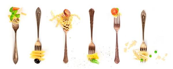 Italian food collage. Pasta design elements. Many forks with pasta and various addings, shot from above on a white background