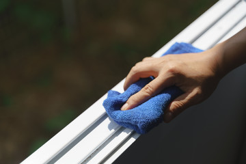 Hand holding microfiber cloth for cleaning
