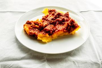 Italian Cuisine Polenta with Meat Sauce Photo Still Life