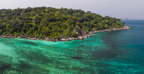 A diving trip in the crystal clear water in front of a lonely island in Southeast Asia