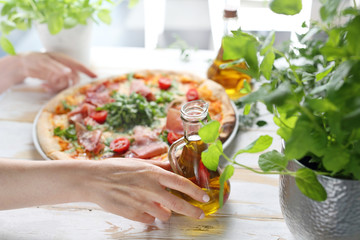 Pizza, traditional Italian pizza on a thin crunchy dough with Parma ham, tomatoes and green rocket salad.