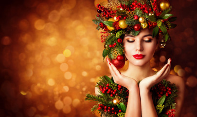 Christmas Face and Hands Skin Care, Woman Beauty Makeup, Art Wreath Hairstyle, Xmas Beautiful Portrait, Model looking to Product on Hand