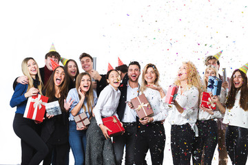 Beautiful people having fun on a white background. Concept celebrating New Year or Christmas.