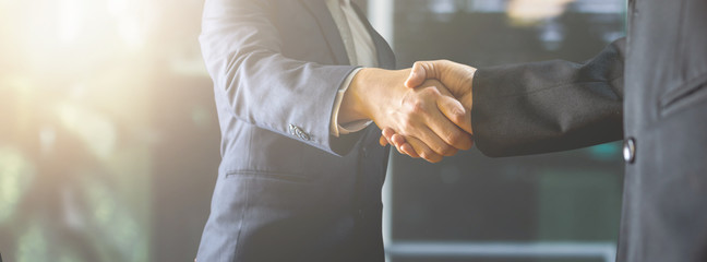 successful negotiate and handshake concept, two businessman shake hand with parthner to celebration partnership and teamwork, business deal
