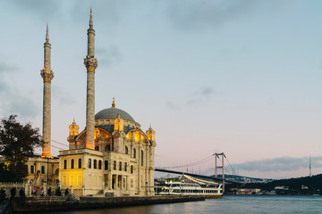 Old historical Ortakoy Mosque with long exposure and behind there is bosporus