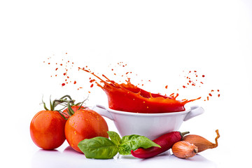 ingredients with vegetables, and tomato puree, with a splash