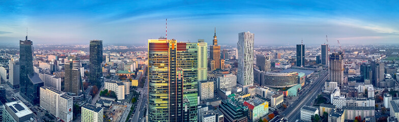 """Beautiful panoramic aerial drone view to panorama cityscape of Warsaw modern City, PKiN and """"Rondo 1"""" office skyscraper located at Rondo ONZ"""