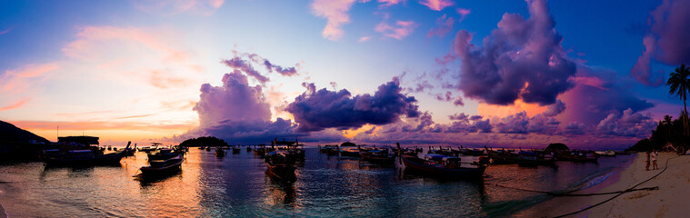 Panorama view of sunrise morning beach with boat sky cloud
