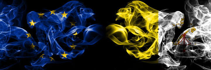 Eu, European union vs Vatican, city smoke flags placed side by side. Thick colored silky smokes abstract flags