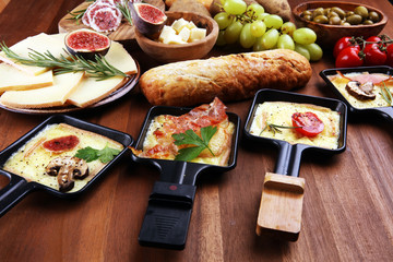 Delicious traditional Swiss melted raclette cheese on diced boiled or baked potato.