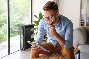 Young Man looking at digital tablet