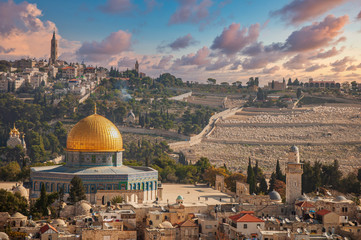 Jerusalem old town skyline with the dome of the rock in the center before sunset