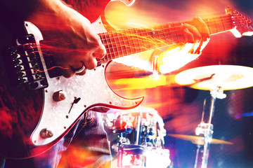 Stage lights.Abstract musical background.Playing guitar and concert concept.Live music background.Music festival.Instrument on stage and band