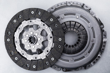 Close-up picture of a part of car, black clutch disk isolated on white background