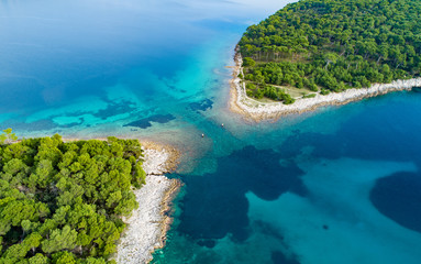 Vertical aerial image of motor boat passing strait close to the coast on the island of Losinj ( Cres ), Croatia.