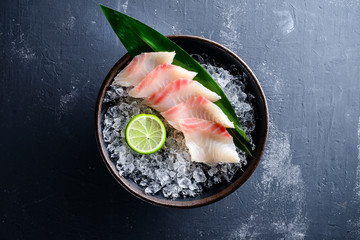 Sashimi Japanese food, slices of sashimi perch on ice. Sliced fish in an expensive restaurant