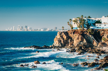 Mazatlan as seen from afar with a spectacular cliff line in the foreground
