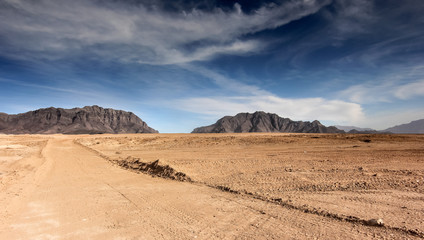 Afghanistan landscape, desert plain against the backdrop of mountains