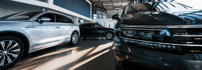 Brand new cars at dealer showroom. Perfectly polished. Natural lighting