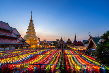 The light of the Beautiful Lanna lamp lantern are northern thai style lanterns in Loi Krathong or Yi Peng Festival at Wat Phra That Hariphunchai is a Buddhist temple in Lamphun, Thailand.