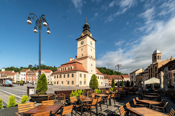 The famous Sfatului square in the heart of Brasov medieval old town in Romania on a sunny summer day