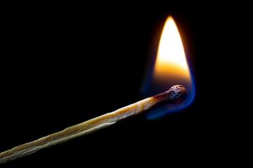Burning match on black