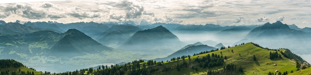 Beautiful panoramic view on Swiss Alps around Lake Lucerne as seen from top of Rigi Kulm peak