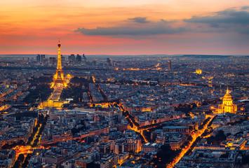 Paris Skyline at Night. Paris, France skyline, panorama at night. The view from Montpanasse Tower. Paris skyline by night. With illuminated city, Invalides, and arc de Triomphe. Paris, France.