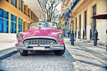 Old Buik pink car parked in a street of havana city