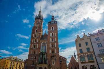 Church of St. Mary and the Cloth Hall in the main Market Square -Rynek Glowny in the city of Krakow in Poland.