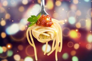 Fork with just spaghetti around it on backgrouund