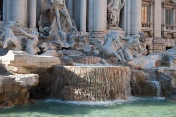 The Trevi Fountain, famous roman fountain in the baroque style of the 18th century, in Piazza di Trevi. Ancient and historical landmark in Europe. On a sunny summer day with blue sky. Fontana di Trevi