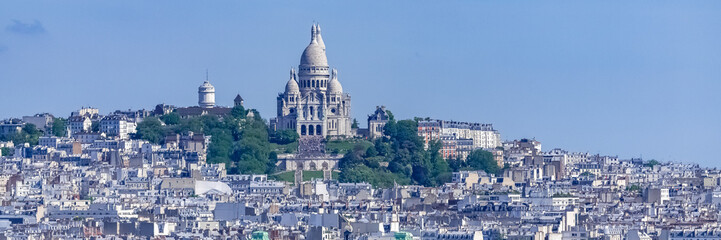 Paris, panorama of the city, typical roofs and buildings, with Montmartre and the Sacre-Choeur basilica in background